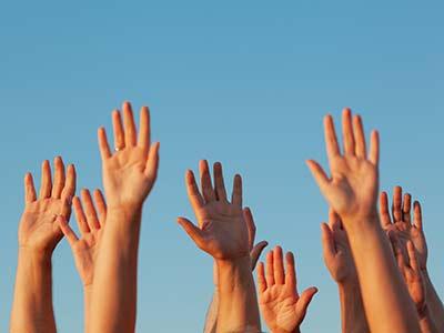 ten-raised-hands-KF2BZS3